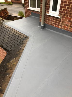 Flat roof to side of house
