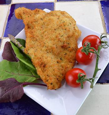 Traditional chicken kiev in a plain breadcrumb