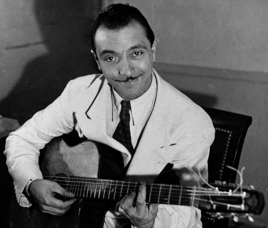 Django Reinhardt playing a Selmer guitar