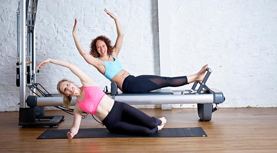 Zoisa Holder and 4U Pilates member demonstrate Pilates moves at the Somerton Studio