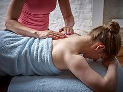 Zoisa Holder providing massage treatment to a 4U Pilates & Wellbeing member