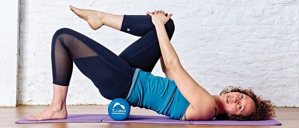 Zoisa Holder owner of 4U Pilates in Pilates pose.