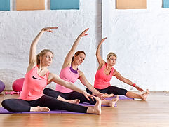 Pilates Group Class demonstrating a pilates movement in a 4U Pilates session.