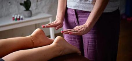 4U Pilates owner Zoisa Holder providing a Reiki treatment