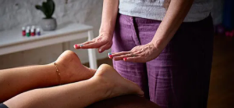 4U Pilates owner Zoisa Holder providing a Reiki treatment