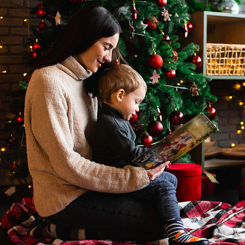 mother-reading-christmas-story-to-her-ch