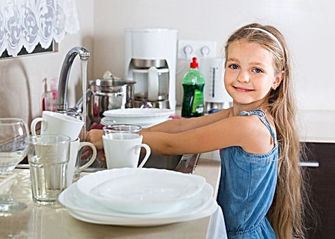 female-child-cleaning-dishware-at-home.j