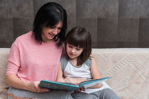 mother-and-little-daughter-reading-book-