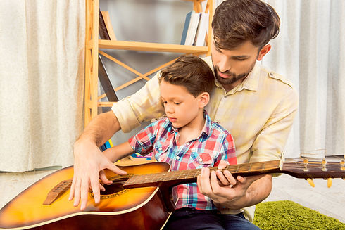 young-father-teaching-his-little-son-to-