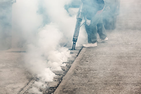 worker-fogging-street-drain-with-insecti