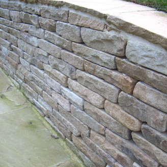 Alun Gredrych - Dry stone wall using Mint fossil Stones