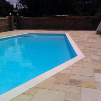 Alun Gedrych Ltd - Sandstone patio around swimming pool