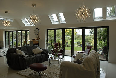Bi-Folding Doors Aluminium Modern Contemporay Folding door tri-folding burgess hill haywards heath sussex FENSA