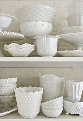 assorted milk glass vases and baskets