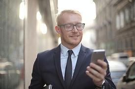 smiling-male-entrepreneur-in-eyeglasses-