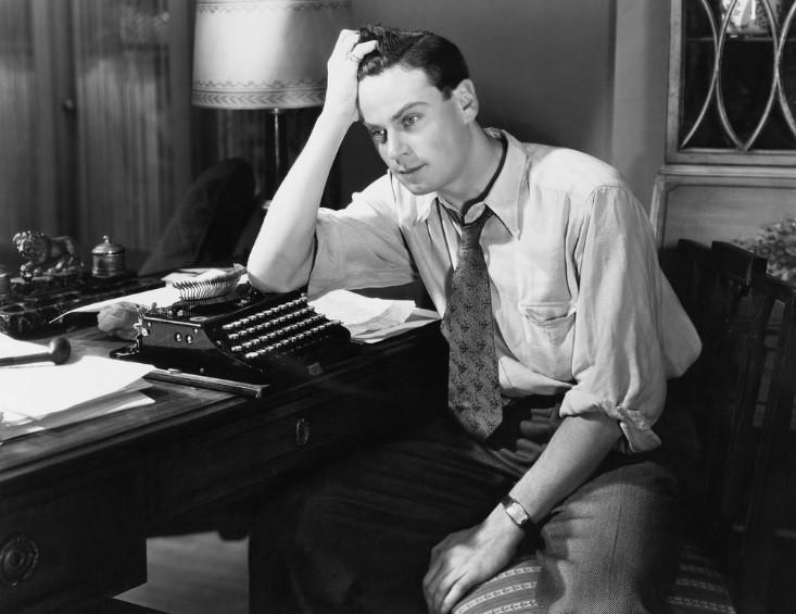 Frustrated writer at old typewriter