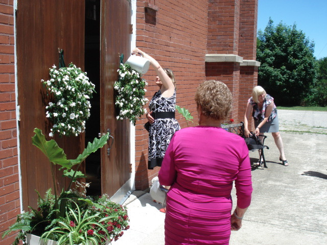 White impatiens on the church doors make a great backdrop for Bride & Groom!
