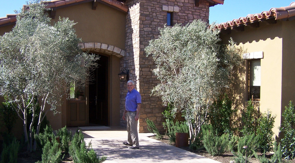 Tuscan villa and landscaping with Roger Pilley on the walk leading to the front door