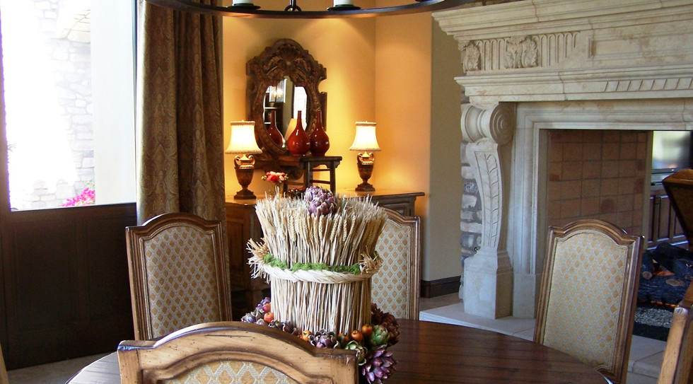 Elegant dining room on the other side of the two-sided fireplace