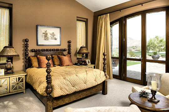 Warm and comfortable bedroom with French doors opening out onto the terrace