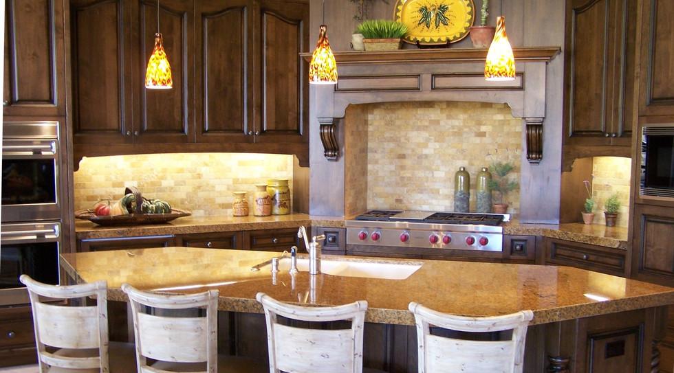 Tuscan-styled kitchen with island cum breakfast bar and artglass pendant lights
