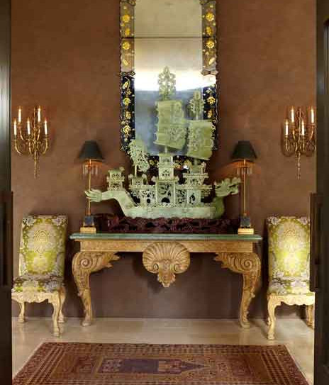 Entryway with Venetian plaster walls and Chinese jade ship