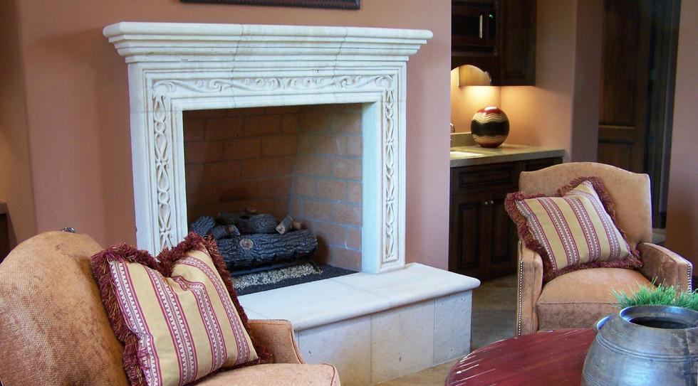 Elegant fireplace, rosey tones, comfortable gathering space