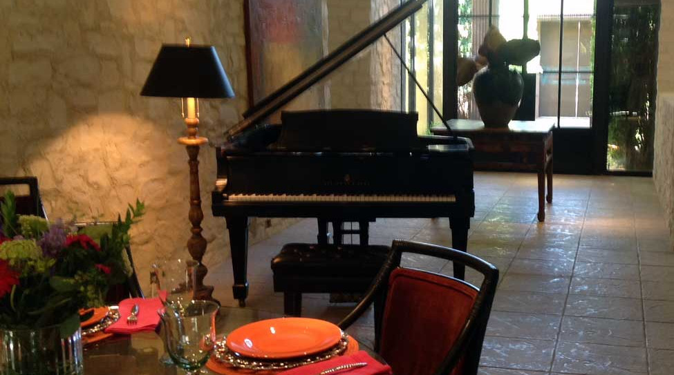 Dining room with grand piano nearby