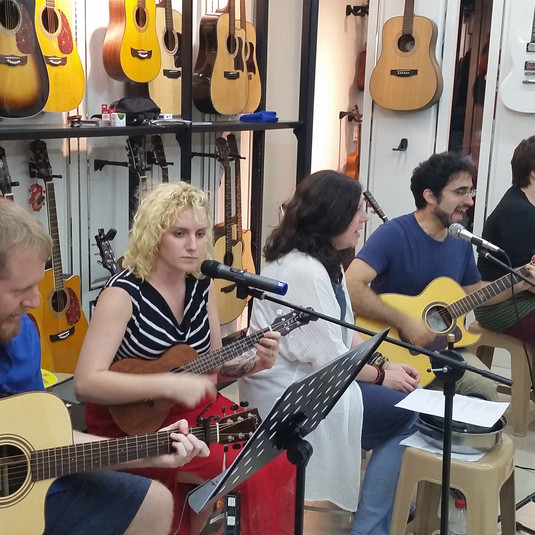 Teachers performing in town music store