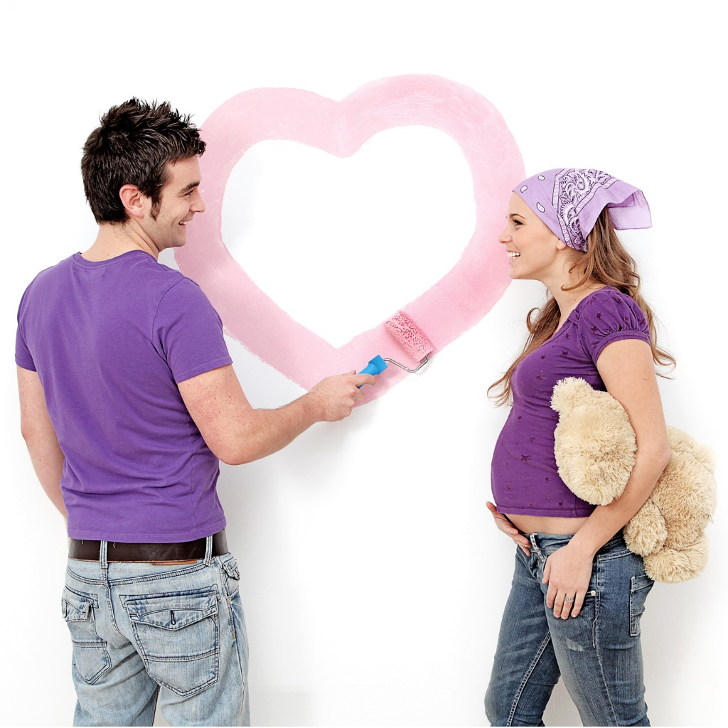 young-couple-painting-nursery-picture-id146795265