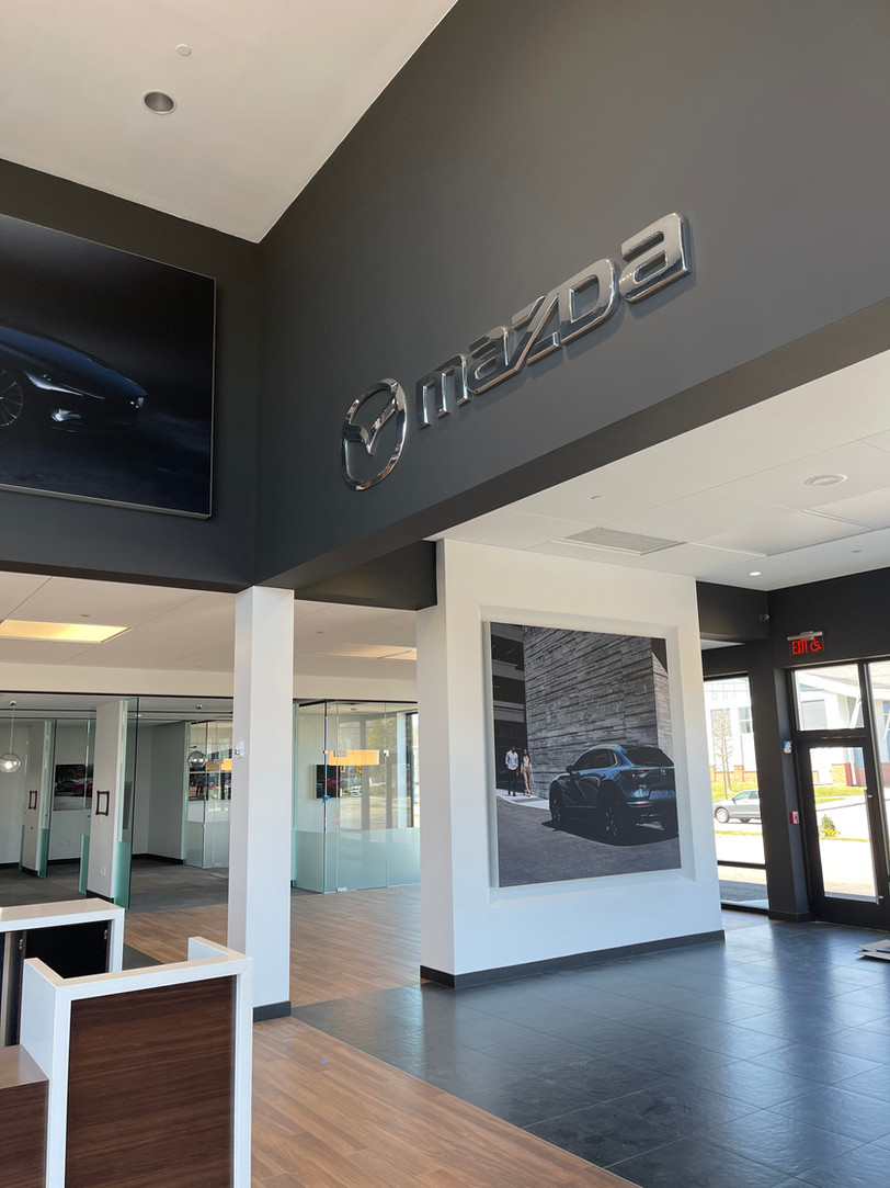 It may be snowing outside today, but interior finishes are progressing nicely at Cape Cod Mazda!