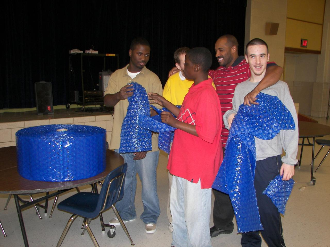 Dereck_handing_out_bubble_wrap.