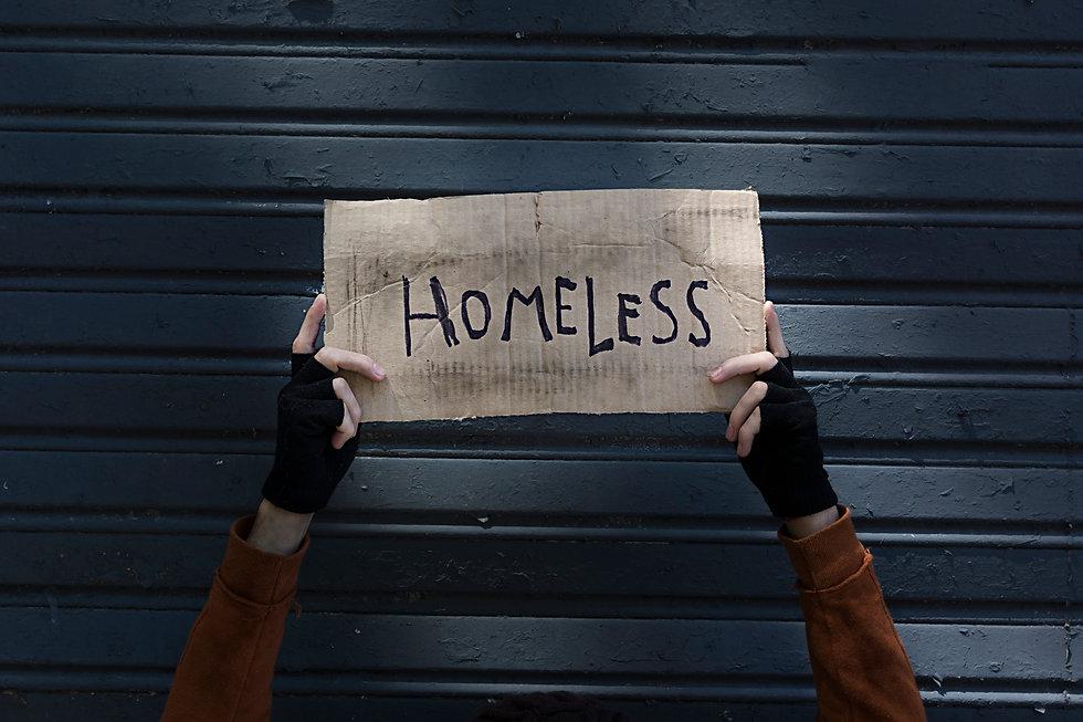 homeless-sign-held-by-beggar-hands.jpg