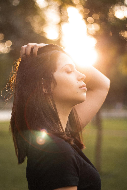 Woman breathing outside