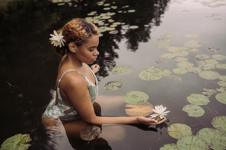 creative female portrait in waterlilies