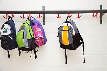 backpacks-hanging-on-hooks.jpg