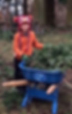 Boy with wheel barrow.jpg