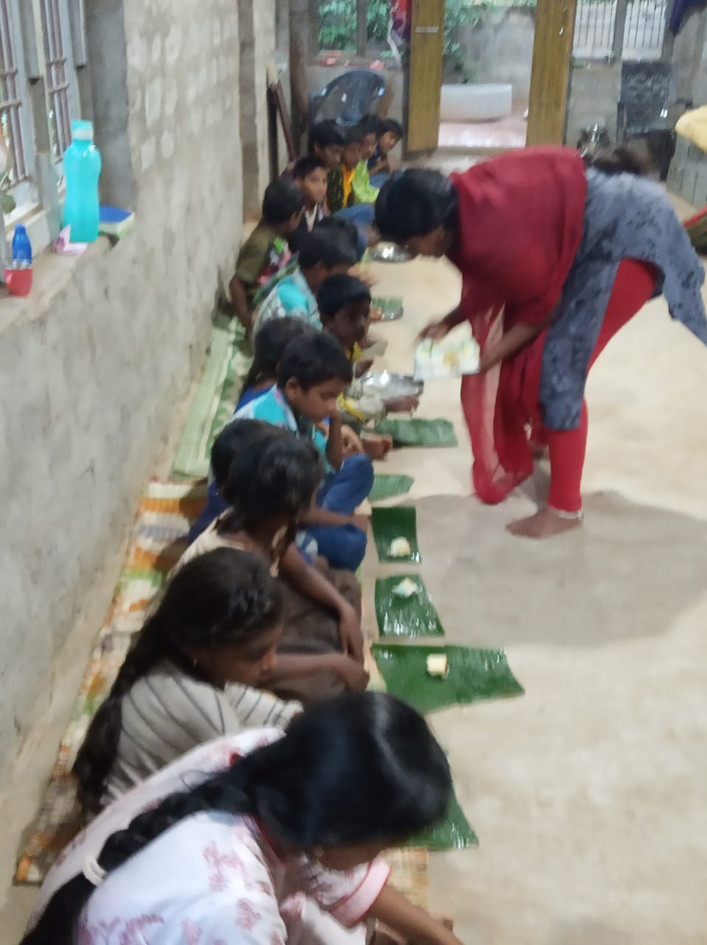 MaryBabu-feeds-Orphans-on-leaves.JPG