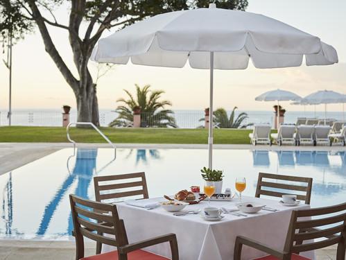 belmond-madeira-pool-breakfast.jpg