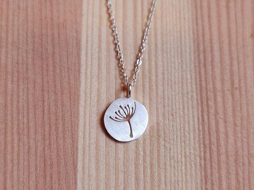 Engraved dandelion on full circle