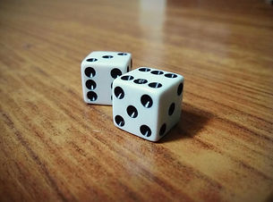 Dice_on_the_table_six_and_five.jpg
