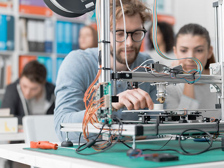 students-using-a-3d-printer-PJKMSXD.jpg