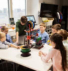 happy-children-with-3d-printer-at-robotics-school-PF3BF2Z_edited.jpg