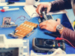 technicians-working-on-electronics-parts-P2HE5US_edited.jpg