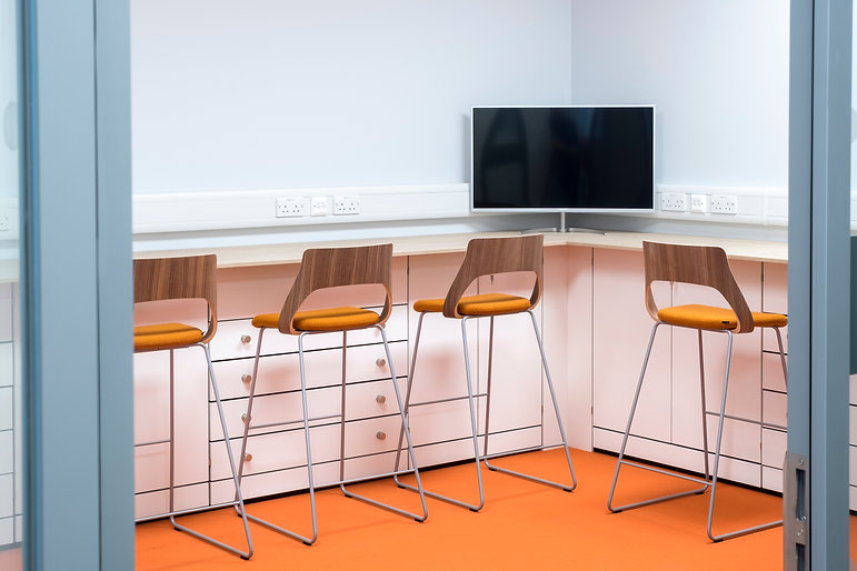 Runs of Freewall's low level storagewall fill a workplace. There are several variations of storagewall, from 2 door lockable units, to small drawer front units. The worktop overhangs the front of the storagewall so that chairs can be pulled up underneath.