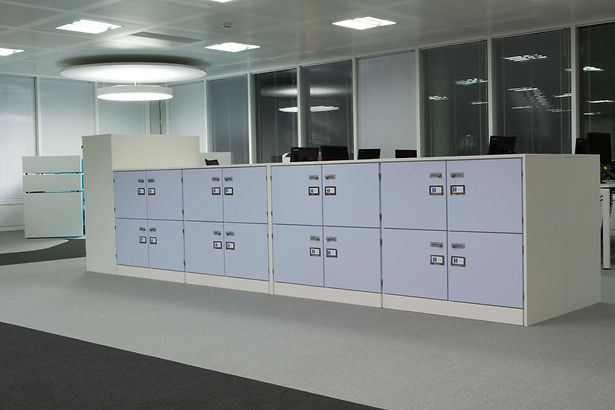 A series of Freewall's pre-built locker units in an office space
