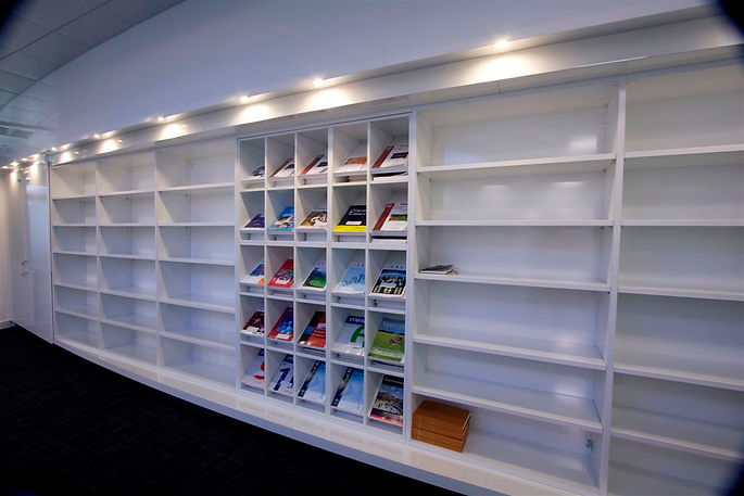 Storagewall designed to act as book shelves. These open faced Freewall units are finished in white and contain several adjustable shelves.