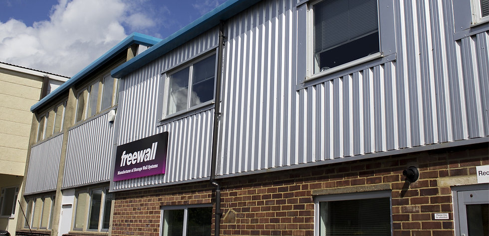 The front face of Freewalls storagewall manufacturing centre. The Freewall logo can be seen on the front of the building