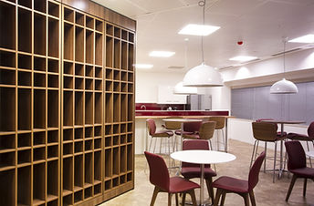 Freewall pigeon hole units installed in an employee break area. The pigeon holes are finished in walnut.