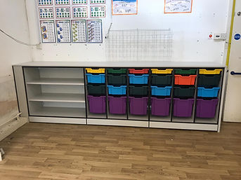 Freewall Teacherwall installed in the corner of a classroom. This is a low level version of teacherwall, and is fitted with shelves and Gratnel Tray storage